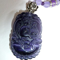 Purple cats eye carved monkey pendant