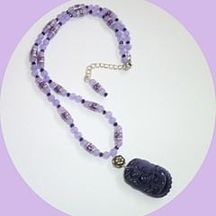 Purple cats eye carved pendant