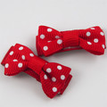 Pair of red and white polka bow baby snap hair clips