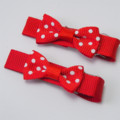 Pair of red and white polka dot bows.