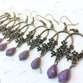 Pretty Bronze Tone Metal Flower Oval Charm Opaque Purple Drop Glass Earrings