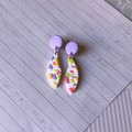 Shimmery white and colourful terrazzo leaf drops, purple stud-top