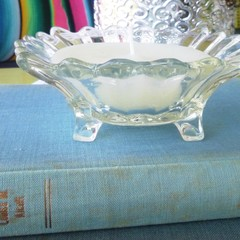 Small candle in vintage glass dish