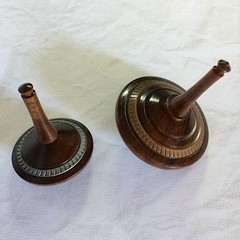 Two Turned Spinning Tops 'Argentea Timber' (Items A 100 a & b)