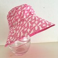 Girls summer hat in pink dino fabric