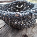 Crocheted basket made from hemp and newspaper yarns. Eco-friendly homeware