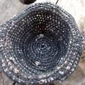 Crocheted basket made from hemp and newspaper yarns. Eco-friendly homeware