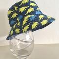 Boys summer hat in blue & yellow dino fabric