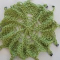 crocheted beaded jug cover, medium. lime green hemp with oval hematite beads