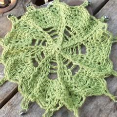 crocheted beaded jug cover, medium. lime green hemp with oval hematite beads