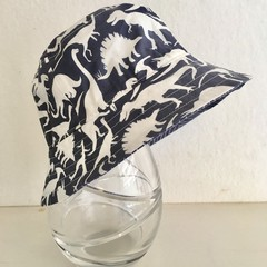 Boys summer hat in blue & white dino fabric