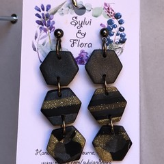 Gold, black, and shimmery platinum hexagon dangle earrings