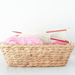 Styled  Stock Photo - Basket of Pink and White Wool with Knitting Needles