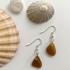 Brown sea glass dangles