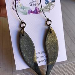 Gold, black and shimmery platinum leaf-shaped statement dangles