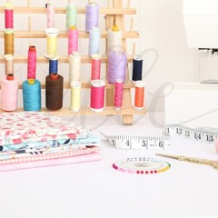 Sewing Stock Photo with Cotton Reel Rack and Sewing Machine