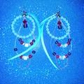 Beautiful beaded feather hoop earrings