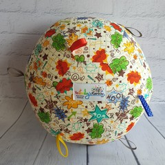 Balloon Ball:  Kapow print on Cream. Taggie