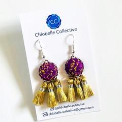 Small purple and gold tassel dangles