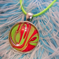 MARBLED ROUND PENDANT - Red and Green Marbling Under a Glass Cabachon