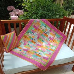 NO. 56 - PINK/GREEN AND ORANGE PATCH QUILT/PLAY MAT AND CUSHION 104CMS X 91CMS