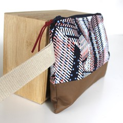 Modern graphic navy and red ladies wristlet bag