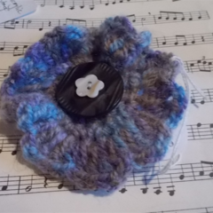 Crocheted clip made from mohair blend yarn with vintage and shell buttons.