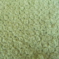 Hand crocheted mohair cot blanket in soft green