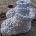 crochet baby boots made from pale blue and white acrylic