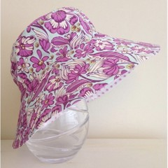 Girls wide brim summer hat in purple floral fabric