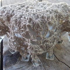 crocheted beaded jug cover, medium. natural hemp yarn with square metal buttons