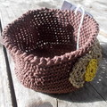 Crocheted bowl made from waxed cotton, chocolate brown with decorations