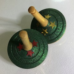 Two Wooden Spinning Tops with Green Glitter and Stars (Items R 113 a & b)