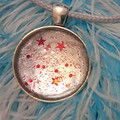 MARBLED ROUND PENDANT  WITH STARS - nail polish marbling under a glass cabachon