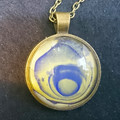 MARBLED ROUND PENDANT WITH CHAIN- Yellow & Blue  Marbling Under a Glass Cabachon