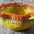 Crocheted bowl made from waxed cotton, yellow with orange and biege trim