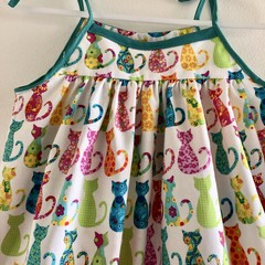 White background cotton for this beautiful summer dress size 5.