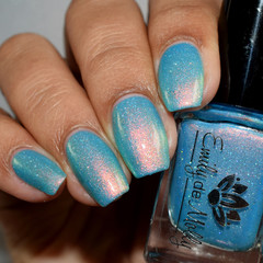 "Nail polish - ""Twenty Questions"" A neon sky blue with copper shimmer and glitter"