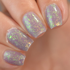 "Nail polish - ""Reruns"" A pale dusty purple base filled with iridescent flakes"