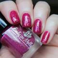 """Nail polish - """"Euro Trip"""" A dark pink base filled with iridescent shifting flake"""