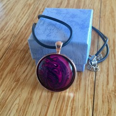 A unique hand painted glass pendant on a leatherette tube style necklace