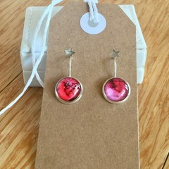 Unique hand painted earrings in a nickel free silver style setting.