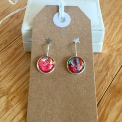 Unique hand painted earrings in a nickel free silver-coloured metal setting.