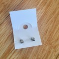 Unique hand painted stud earrings in a nickel free silver-coloured metal setting
