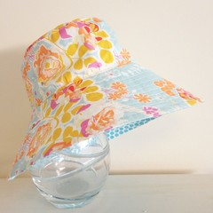 Girls wide brim summer hat in blue floral fabric