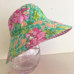 Girls wide brim summer hat in green floral fabric