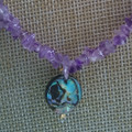 AMETHYST CHIP BEAD NECKLACE WITH SHELL FEATURE BEAD