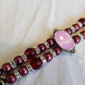 Handmade vintage looking beaded bracelet with pink spacers and red glass pearls