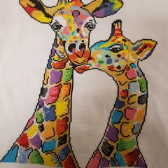 Colourful giraffe completed cross stitch