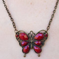 Gorgeous antique looking red butterfly necklace